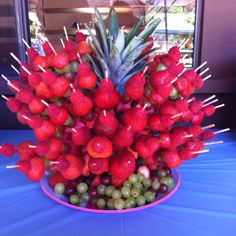 Great party idea! Fruit kabob skewers in a pineapple. Perfect for the hot summer weather!