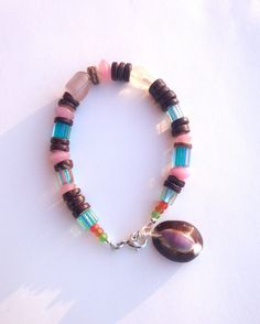 Beach Bracelet with Pink Fluorite and Cane Glass, Boho Bracelet, Unique Rustic Bracelet https://www.etsy.com/listing/262334337/beach-bracelet-with-pink-fluorite-and?utm_campaign=crowdfire&utm_content=crowdfire&utm_medium=social&utm_source=pinterest