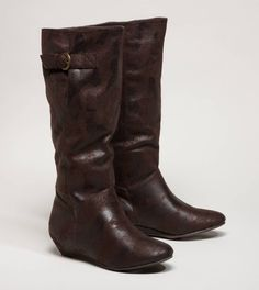 need these! much harder than you'd think to find stylish high boots with a low-heel that don't give off a cowgirl vibe
