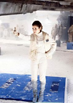 Carrie Fisher posing on Echo Base set.