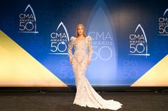 Beyonce in a beads and crystals mermaid dress at the red carpet of CMA
