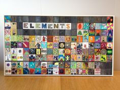 Periodic table auction project.  Painted wood squares.