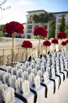 Escort cards in a picture frame - a great idea for a way to combine a wedding favor everyone can use with the escort cards. Photographer: Pickerill Creative / Event Planner: Behind the Scene / Reception Venue: St. Regis Resort Monarch Beach