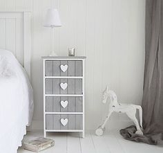 Heart Cottage grey and white chest of 4 drawers as bedside table. The White Lighthouse offers a range of bedroom furniture and accessories with a combination of Coastal, Scandi, Danish, French, Shabby Chic and New England styles