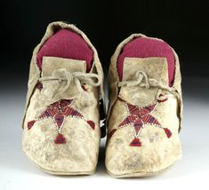 Bid now on Invaluable: 20th C. Plains Indian Beaded Hide Moccasins (pr) from Artemis Gallery on March 4, 0121 8:00 AM MDT. Native American Moccasins, Deer Hide, Plains Indians, Five Pointed Star, Red Interiors, Shades Of Red, Dark Red, Blue Stripes, Baby Shoes