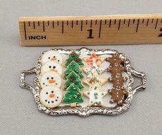Dollhouse Miniature 16 Christmas Cookies on Metal Tray. $14.99, via Etsy.