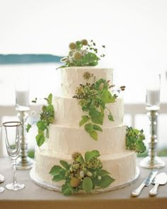 Wild berry foliage added a rustic accent to this Sugar Tree multilayered carrot cake with raspberry and vanilla filling that Maggie and Jason served at their black-tie wedding in Port Clyde, Maine.
