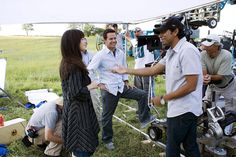 "Director M Night Shyamalan talks to Mark Wahlberg and Zooey Deschanel on-set of ""The Happening"""