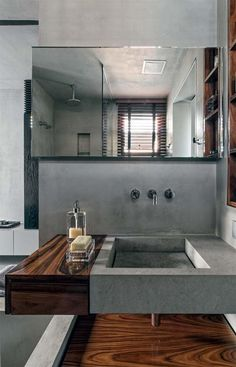 Concrete + Wood Lacquer/stone finish. Minimalistic chic.
