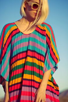 striped accordian pleat fab retro 70s kaftan caftan    . BOLD multi colored stripes  . accordian pleats  . length - 56 from neckline    WOW! // one size fits most    www.jamessociety.com    FOLLOW US ON INSTGRAM FOR UPDATES >>> @jamessociety