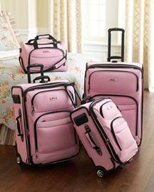 Pink. i want this luggage...someday....if only I had a place to go