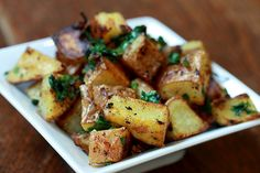 boiled, baked and fried potato dish with lemon, garlic and coriander! yum!
