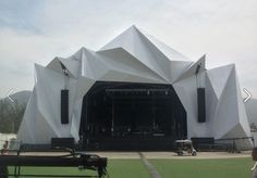 Outdoor stage shroud; angular architecture; white