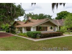 Welcome to this one of a kind Ocala Historic District 3 bdr/2 bath home with attached apartment. The beautifully landscaped 1/2 acre lot invites you to the peaceful front porch and charm of the home. Wood flooring and tile throughout, updated kitchen and bathrooms. Separate entry to 1 bdr/1 bath apt overlooking the spacious iron fenced backyard. Brick driveway, outdoor deck and workshop, too. Don't miss out! ML#424598