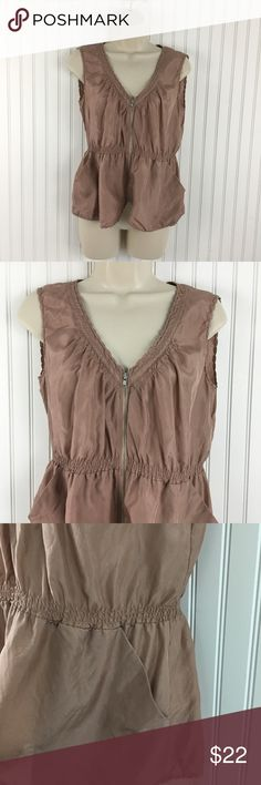 """J. Crew 100% silk zip front Blouse J. Crew 100 % silk oversized zip front Blouse.   Smocked around the waist. 2 front pockets. Gathered around the neckline.  The color is close to a dusky rose gold. Very good condition no rips stains or holes Approximate measurements flat across Chest:20"""" Waist: 15"""" Length:23"""". J. Crew Tops Blouses"""