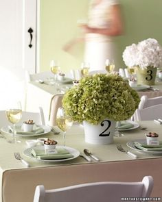 "See the ""Low-Key Hydrangea"" in our 17 Simple Wedding Centerpieces gallery-with white gray and maybe blue flowers."