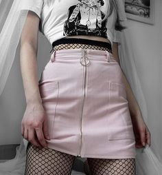 Love this punk style with the soft pink tones of the skirt but the black fishnets giving it an edgy look.