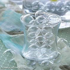 Centerpiece kits, including floating candle centerpieces, centerpiece elements and table top decor. Small Glass Vases, Glass Cylinder Vases, Clear Glass, Floating Candle Centerpieces, Party Centerpieces, Table Decorations, Bubble Bash, Bubble Birthday Parties, 30th Birthday