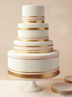 Gold & White Wedding Cake. Very pretty. I think a few red roses added to it might look nice as well.