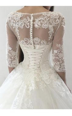 Love the lace ties on the back of this beautiful wedding gown