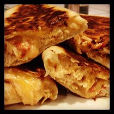 Slow Cooker Chicken Quesadillas ~ chicken, can of Rotel tomatoes and 2 oz cream cheese. It's to die for on a grilled wrap!