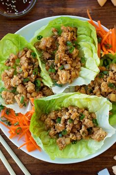 This PF Chang's Lettuce Wraps recipe is a copycat of a restaurant favorite. A mixture of ground chicken, minced mushrooms, and onions, seasoned and cooked in oriental sauces and wrapped in fresh lettuce. The chicken lettuce wraps are light, yet fil Pf Changs Chicken Lettuce Wraps Recipe, Lettuce Wrap Recipes, Thai Chicken Lettuce Wraps, Ground Turkey Lettuce Wraps, Healthy Lettuce Wraps, Asian Lettuce Wraps, Best Lettuce For Wraps, Lettuce Wrap Sauce, Asian Chicken Wraps