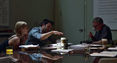 Rosamund Pike and Ben Affleck go over the 'Gone Girl' script with Director David Fincher.