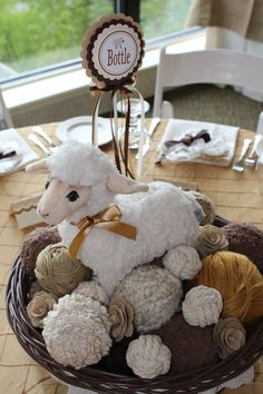 Centerpieces are yarn balls and lamb in baskets