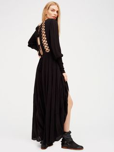 Wednesday Maxi | Made from our sheer and gauzy Endless Summer fabric, this breezy long sleeve maxi dress with a lovely V-neckline features gorgeous lace-up back designs with tassel accents on the ties. Smocked details on the bodice and sleeve cuffs. Comfortable, flowy silhouette. Throw on top of a bikini or layer over one of our seamless styles for an effortless look.