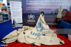 Project ambassador of Louise Owen models a UN tent from the Zaatari camp in Jordan that has been converted into a dress by fashion academic Helen Storey at the Dubai Humanitarian Aid and Development conference and Exhibition in Dubai on March 22, 2017. /