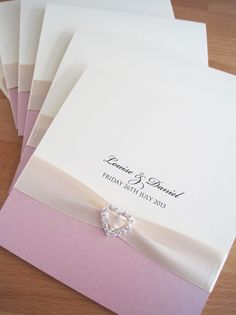 Albany Pocketfold Wedding Invitations in cream and dusky pink and finished with cream ribbon and a crystal heart.