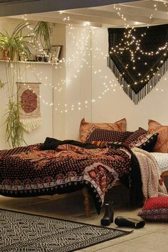 Cosy boho bedroom you'll never want to leave! Wall plants and tapestries are never a miss. With hanging fairy lights and cosy cushions, this makes a perfect hippy bedroom to relax and unwind in... Image credit to: Runaway Gypsy #boho #bohemian #gypsy #lights #fairylights #style #bedroom #quilt #cosy #soft #hippy #hippie #bohostyle #share #follow #hippielove #❤️ #freesoul