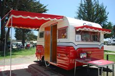 shelley and Jims corvette vintage travel trailer red