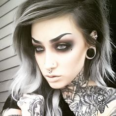 Idk what I like more, her makeup or her tattoos<3                                                                                                                                                                                 More