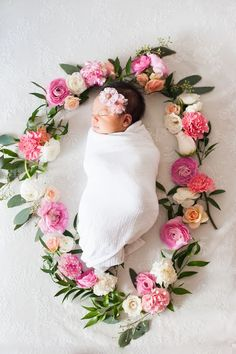 baby in flower wreath and natural lighting