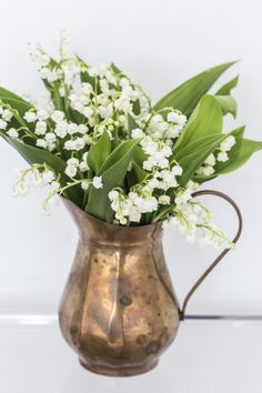 Lily of the valley bouquet in a copper pitcher