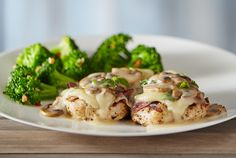 Pollo Rosa Maria - Wood-grilled and topped with fontina cheese, prosciutto, mushrooms and our basil lemon butter sauce