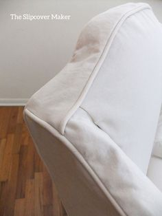 Slipcover detail: a smooth, tailored panel bridges front to back. Replaces gathers and darts.