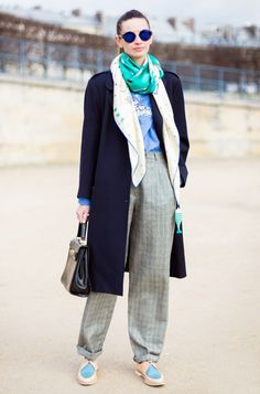 Colorful blue silk scarf + oversized navy coat + blue sweater + printed gray trousers and sneakers