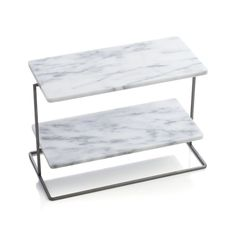 Tiered server upgrades in Ana Reza-Hadden's beautiful, classic design that mixes rectangular marble serving surfaces with a clean iron frame. Designed by Ana Reza-HaddenMarbleIron tube with clear lacquer finishFood safeHand washMade in Taiwan.