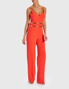 1d478044ca77 Look sleek and sophisticated in the Brooke bright coral jumpsuit. This  flattering coral jumpsuit features a double strap design and gold hardware  waistband ...