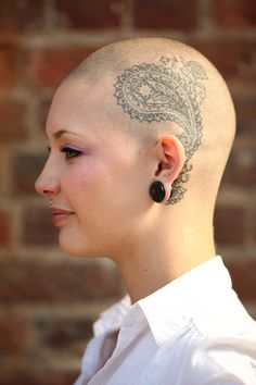 Camilla Caney Tattoo enthusiast Camilla Caney shows off her tattooed head on the opening day of the fifth London Tattoo Convention held at T...