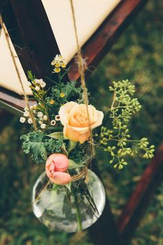 hanging aisle decor, photo by Parker Young http://ruffledblog.com/backyard-tampa-wedding #weddingideas #ceremony #flowers