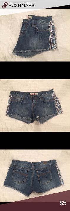 "Aztec denim shorts Wore once while visiting family in New Mexico, in great like new condition. Juniors size 9 lightly distressed denim shorts with Aztec detail going down each hip. Great for the summer! Laying flat: Waist 16"" inseam 2"" top to hem (front) 8"" (back) 9.5"" Price is firm unless bundled. 🎀Comes from a smoke free home. Item is free of stains or rips.🎀 Hot Kiss Shorts Jean Shorts"