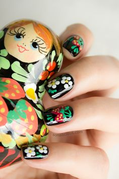 Matryoshka inspired Russian nails.