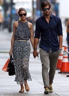 Olivia Palermo and Johannes Huebl  I don't know who these people are. they look well dressed though