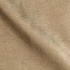 Spoil yourself with this luxurious leather fabric! This supple lightweight cowhide leather is fused to a soft backing of woven rayon- making this leather medium/heavyweight and a dream to sew and wear! With an ultra soft hand, a touch of mechanical stretch and a low luster metallic finish, this leather is perfect for creating jackets, vests, pants, skirts, dresses, and apparel accents such as collars, elbow patches or epaulettes.