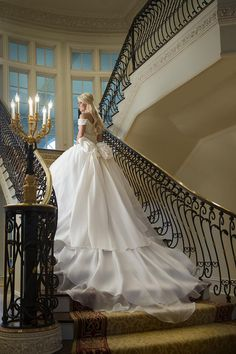 A stunning bridal portrait taken on a grand staircase. Wedding by Kim Huskey of Kimberly's Events. #weddings #bride #ballgown #train #staircase