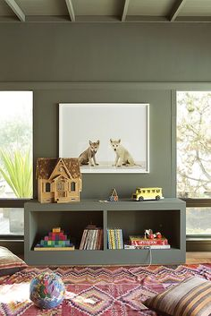 Love these playroom built-ins!!! I actually really dig that paint color on the walls.