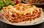 portion of succulent ground beef lasagne topped with melted cheese and garnished with fresh parsley served on a plate in a close up view for a menu Barilla Lasagna Recipe, Beef Lasagne, Lasagna Pan, Greek Cooking, Macaroni And Cheese, Slow Cooker, Favorite Recipes, Meals, Ground Beef